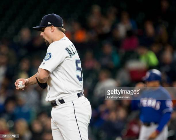 Dan Altavilla of the Seattle Mariners reacts after giving up a solo home run to designated hitter Adrian Beltre of the Texas Rangers in the sixth...