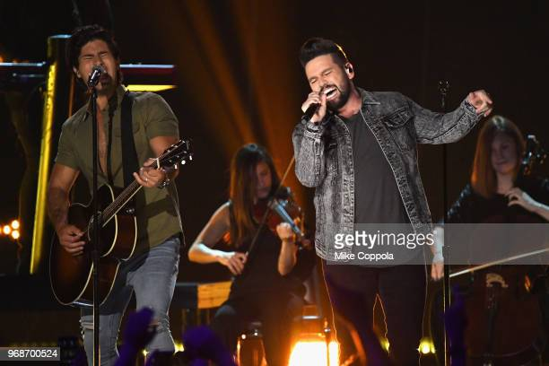 Dan and Shay perform onstage at the 2018 CMT Music Awards at Bridgestone Arena on June 6 2018 in Nashville Tennessee