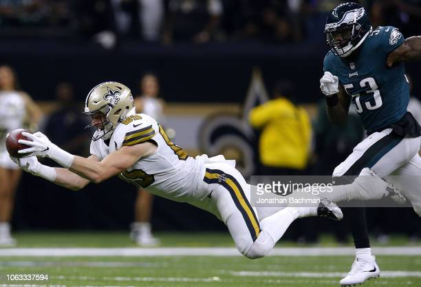 Dan Arnold of the New Orleans Saints catches the ball as Nigel Bradham of the Philadelphia Eagles defends during the first half at the MercedesBenz...