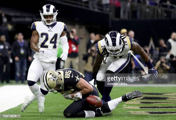 Dan Arnold of the New Orleans Saints misses a catch in the end zone against the Los Angeles Rams during the first quarter in the NFC Championship...