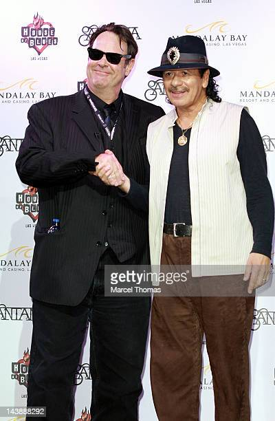Dan Aykroyd and Carlos Santana attends a mud ceremony at the House of Blues Las Vegas on May 4 2012 in Las Vegas Nevada