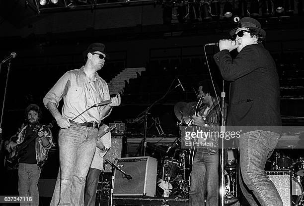 Dan Aykroyd and John Belushi perform during rehearsal for a Blues Brothers concert at Winterland Arena on December 31 1978 in San Francisco California