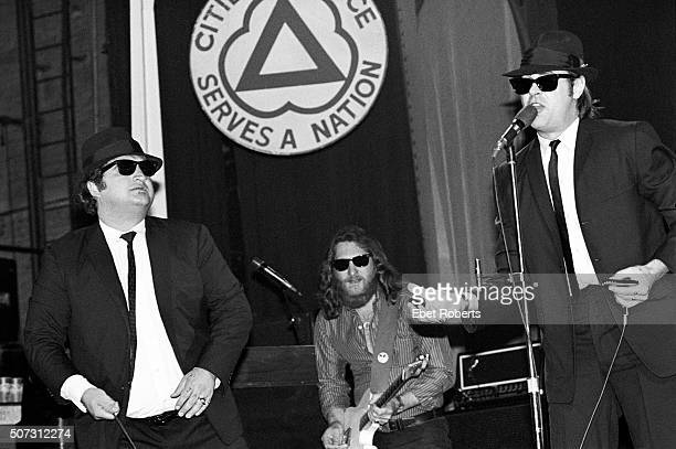 Dan Aykroyd and John Belushi with Steve Cropper in back performing with The Blues Brothers at the Palladium in New York City on June 1 1980