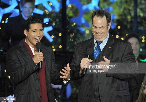 Dan Aykroyd and Mario Lopez attend the annual Hollywood Christmas Celebration at the Grove at The Grove on November 21 2010 in Los Angeles California