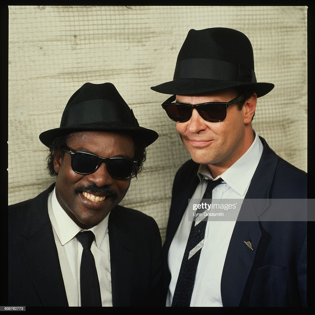 Dan Aykroyd, dressed as Elwood Blues from the movie The Blues Brothers, with singer Sam Moore.