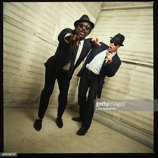 Dan Aykroyd dressed as Elwood Blues from the movie The Blues Brothers dances with singer Sam Moore