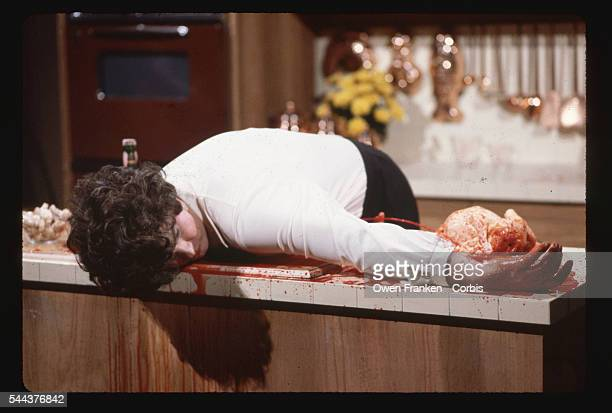 Dan Aykroyd in a Saturday Night Live skit plays Julia Child cutting herself during a cooking show and bleeding to death