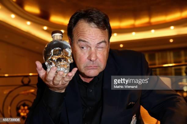 Dan Aykroyd poses with a bottle of 'Crystal Head' vodka at Capella Bar Breidenbacher Hof on September 19, 2014 in Duesseldorf, Germany.
