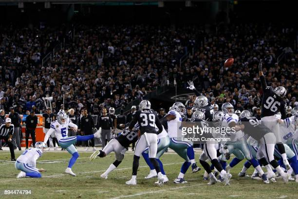 Dan Bailey of the Dallas Cowboys kicks a field goal against the Oakland Raiders during their NFL game at OaklandAlameda County Coliseum on December...
