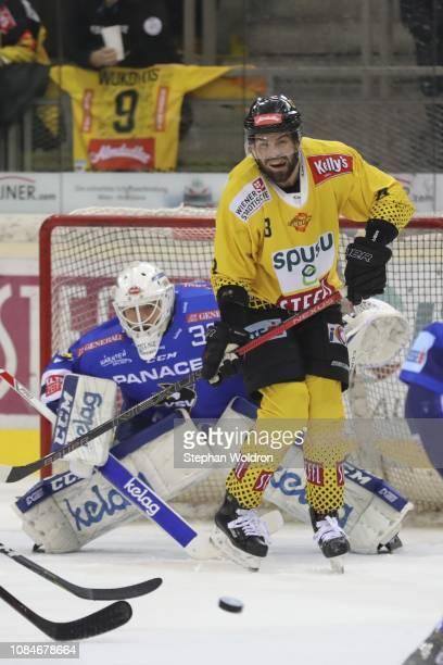 Dan Bakala of Villach and Peter Schneider of Vienna during the Vienna Capitals v EC VSV Erste Bank Eishockey Liga at Erste Bank Arena on January 18...
