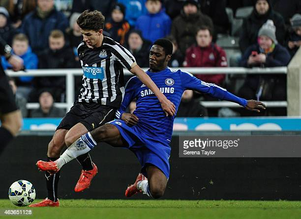 Dan Barlaser of Newcastle controls the ball whilst being challenged by Chelsea's Jay Dasilva during the FA Youth Cup Sixth Round match between...