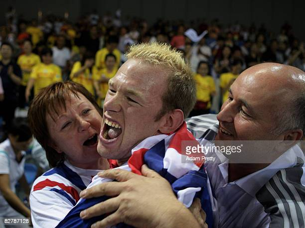 Dan Bentley of Great Britain is congratulated by his mum Sandra and dad Malcom Bentley after winning Gold in the Boccia final between Great Britain...