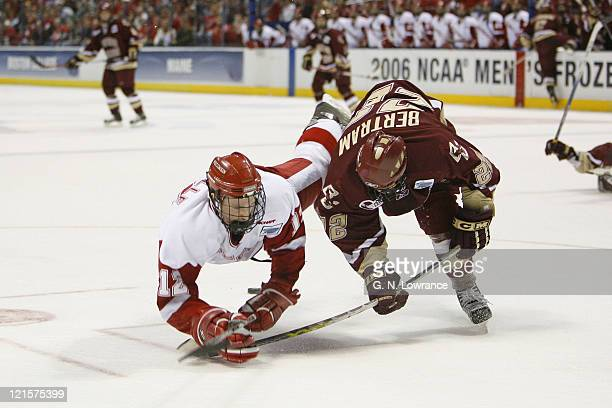 Dan Bertram of Boston College battles with Jack Skille of Wisconsin during 2nd-period action at the NCAA Mens Hockey National Championship at the...