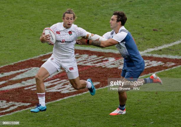 Dan Bibby of England and Jean Pascal Barraque of France during the HSBC London Sevens at Twickenham Stadium on June 2 2018 in London United Kingdom