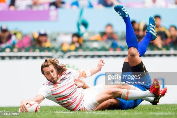 Dan Bibby of England dives over to a try during the 2017 Hong Kong Sevens match between England and Samoa at Hong Kong Stadium on April 8 2017 in...
