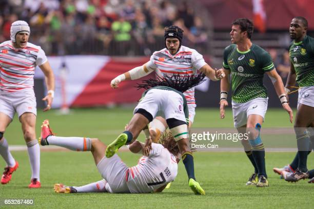 Dan Bibby of England is tackled by Cecil Afrika of South Africa in the Cup Final on day 2 of the 2017 Canada Sevens Rugby Tournament on March 12 2017...