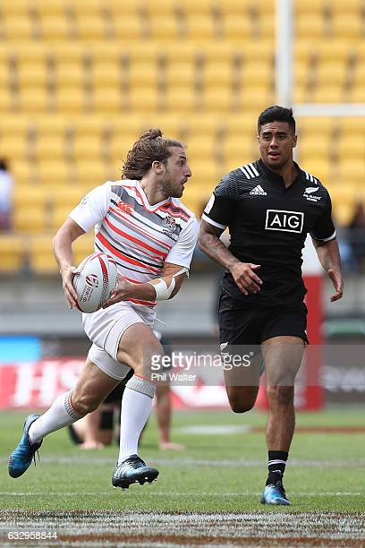 Dan Bibby of England looks to offload the ball in the match between New Zealand and England during the 2017 Wellington Sevens at Westpac Stadium on...