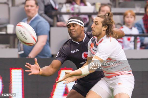 Dan Bibby of England reaches for the ball ahead of a New Zealand opponent during day 2 of the 2017 Canada Sevens Rugby Tournament on March 12 2017 in...