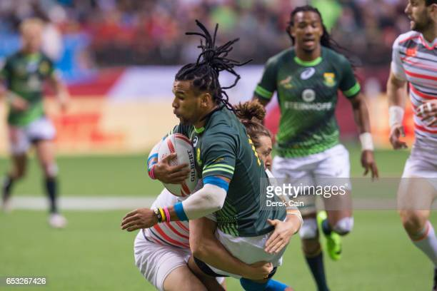 Dan Bibby of England tackles Rosko Specman of South Africa in the Cup Final on day 2 of the 2017 Canada Sevens Rugby Tournament on March 12 2017 in...