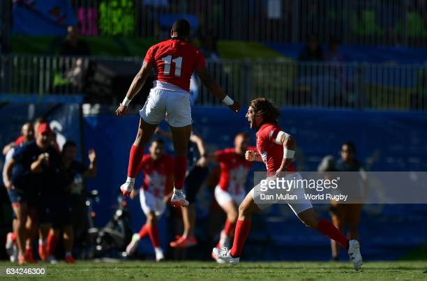 Dan Bibby of Great Britain and Marcus Watson of Great Britain celebrate victory at the final whistle during the Men's Rugby Sevens semi final match...