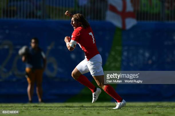 Dan Bibby of Great Britain celebrates victory at the final whistle during the Men's Rugby Sevens semi final match between Great Britain and South...