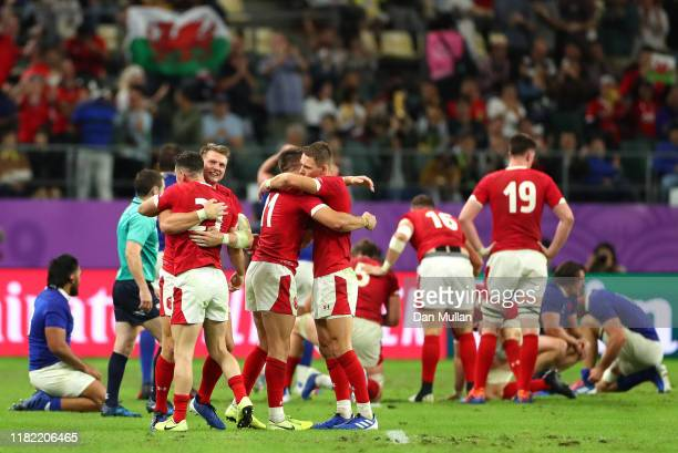 Dan Biggar and Tomos Williams of Wales celebrate victory following the Rugby World Cup 2019 Quarter Final match between Wales and France at Oita...