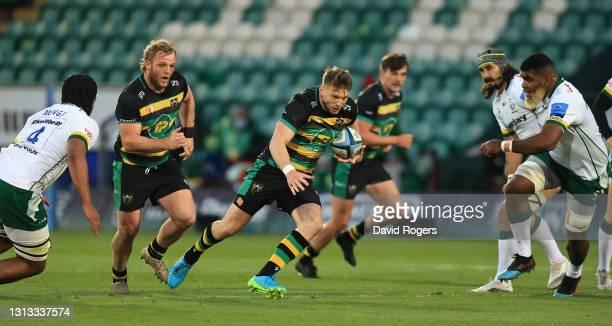 Dan Biggar of Northampton Saints charges upfield during the Gallagher Premiership Rugby match between Northampton Saints and London Irish at...