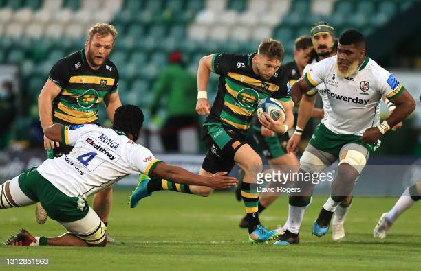 Dan Biggar of Northampton Saints makes a break to set up the first Saints try during the Gallagher Premiership Rugby match between Northampton Saints...