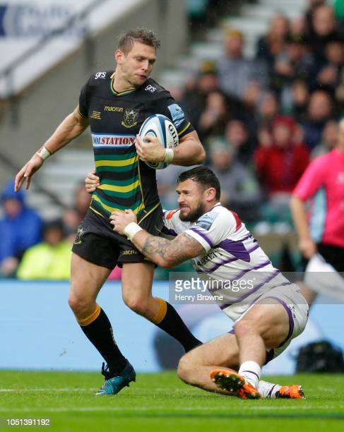 Dan Biggar of Northampton Saints tackled by Adam Thompstone of Leicester Tigers during the Gallagher Premiership Rugby match between Northampton...