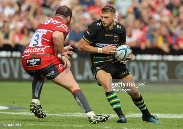 Dan Biggar of Northampton takes on Fraser Balmain during the Gallagher Premiership Rugby match between Gloucester Rugby and Northampton Saints at...