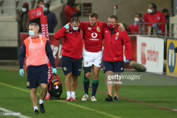 Dan Biggar of the British & Irish Lions is helped from the field with a leg injury during the 3rd Test between South Africa and the British & Irish...