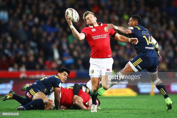 Dan Biggar of the Lions collects the ball during the match between the Highlanders and the British Irish Lions at Forsyth Barr Stadium on June 13...