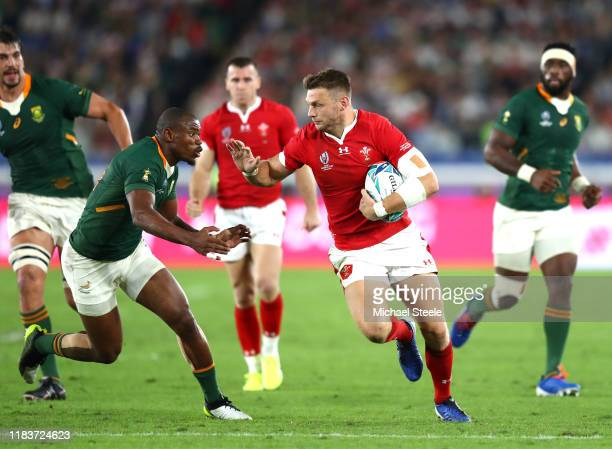 Dan Biggar of Wales fends Makazole Mapimpi of South Africa during the Rugby World Cup 2019 SemiFinal match between Wales and South Africa at...