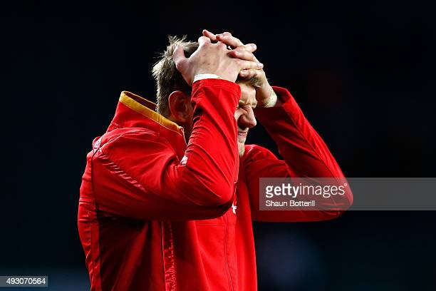 Dan Biggar of Wales holds his head in his hands in anguish following the Wales defeat during the 2015 Rugby World Cup Quarter Final match between...