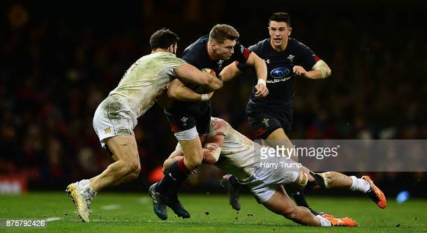 Dan Biggar of Wales is tackled by Mareb Sharikadze of Georgia during the Under Armour Series 2017 match between Wales and Georgia at the Principality...