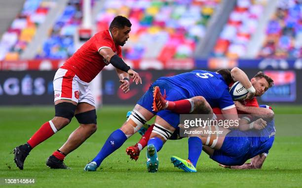 Dan Biggar of Wales is tackled by Paul Willemse and Charles Ollivon of France during the Guinness Six Nations match between France and Wales at Stade...