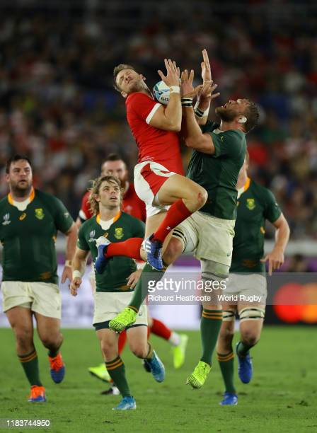Dan Biggar of Wales jumps with Duane Vermeulen of South Africa during the Rugby World Cup 2019 SemiFinal match between Wales and South Africa at...