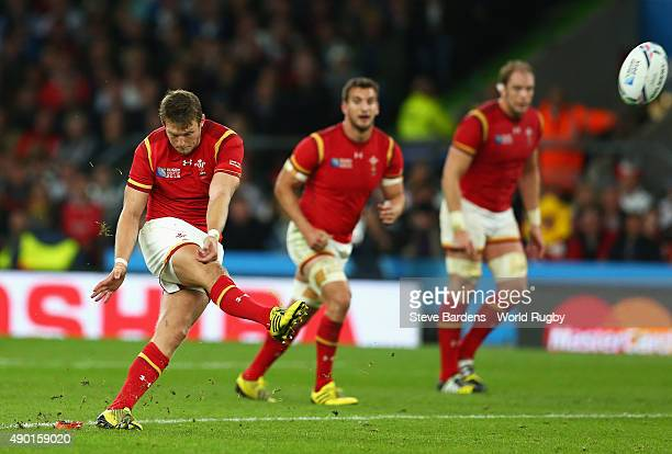 Dan Biggar of Wales kicks the winning penalty during the 2015 Rugby World Cup Pool A match between England and Wales at Twickenham Stadium on...