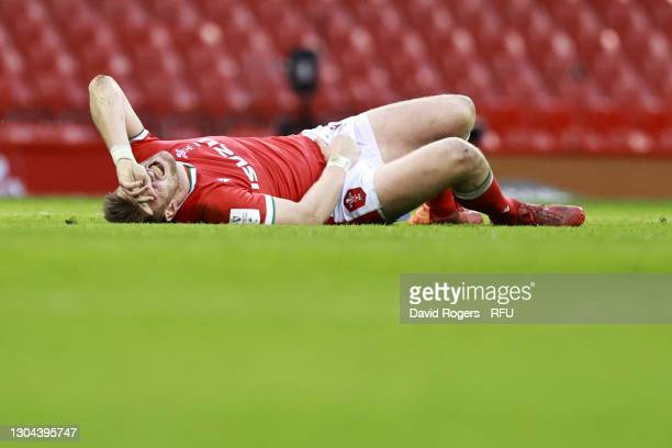 Dan Biggar of Wales lies injured during the Guinness Six Nations match between Wales and England at Principality Stadium on February 27, 2021 in...
