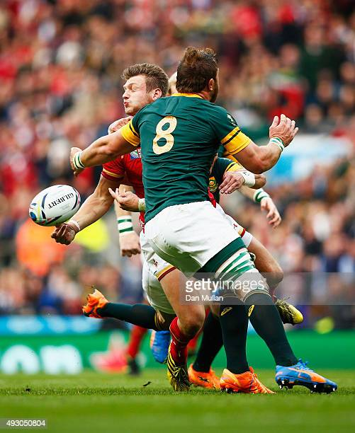 Dan Biggar of Wales off loads under presssure from Duane Vermeulen of South Africa during the build up the first Wales try during the 2015 Rugby...