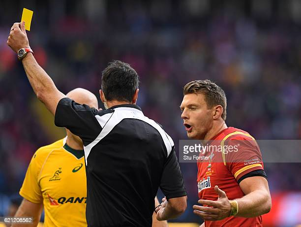 Dan Biggar of Wales remonstrates with Referee Craig Joubert of South Africa as he is shown the yellow card during the international match between...