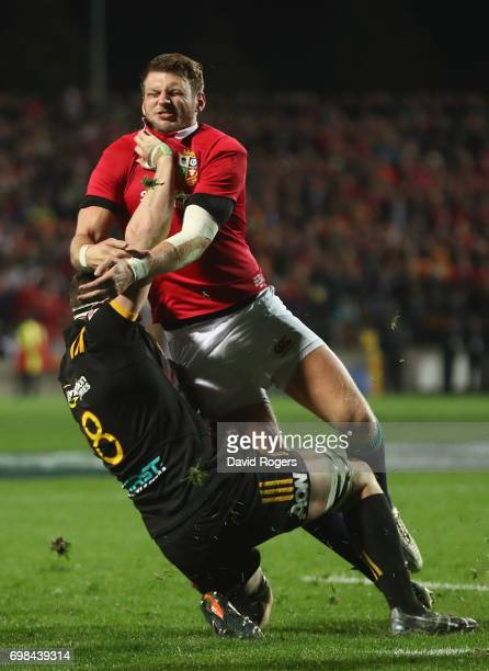 Dan Biggard of the Lions is tackled by Tom Sanders during the match between the Chiefs and the British Irish Lions at Waikato Stadium on June 20 2017...