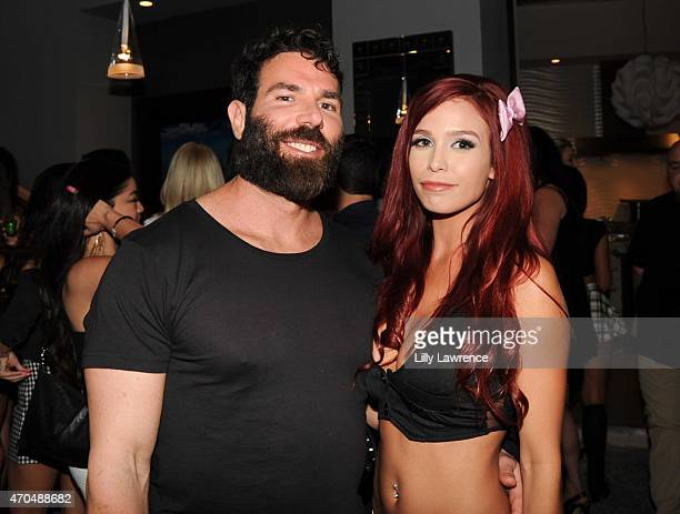 Dan Bilzerian and Tawny Jaclyn attend the Steve Aoki Charity Fund Poker Tournament on April 18 2015 in Los Angeles California