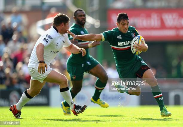 Dan Bowden of Leicester Tigers skips past Rob Vickers of Newcastle Falcons during the Aviva Premiership match between Leicester Tigers and Newcastle...