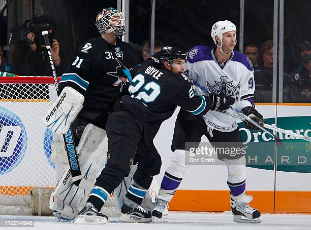 Dan Boyle and Antti Niemi of the San Jose Sharks protect the net against Ryan Smyth of the Los Angeles Kings in Game 1 of the Western Conference...