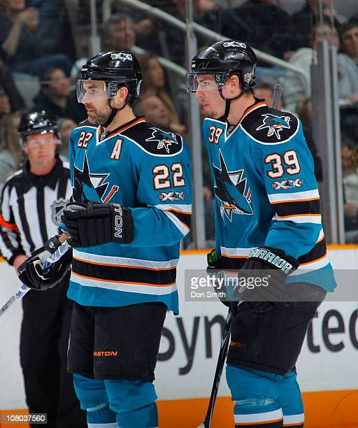 Dan Boyle and Logan Couture of the San Jose Sharks wait for a faceoff against the Toronto Maple Leafs during an NHL game on January 11, 2011 at HP...