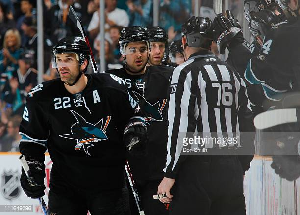 Dan Boyle Devin Setoguchi and Joe Thornton of the San Jose Sharks get high fives from the bench after a goal against the Los Angeles Kings during an...