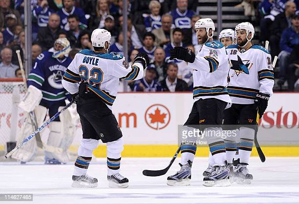 Dan Boyle Joe Thornton Joe Pavelski and Devin Setoguchi of the San Jose Sharks celebrate a goal by teammate Patrick Marleau in the second period as...