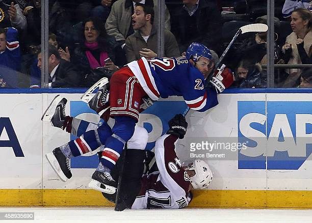 Dan Boyle of the New York Rangers hits Alex Tanguay of the Colorado Avalanche in overtime at Madison Square Garden on November 13 2014 in New York...