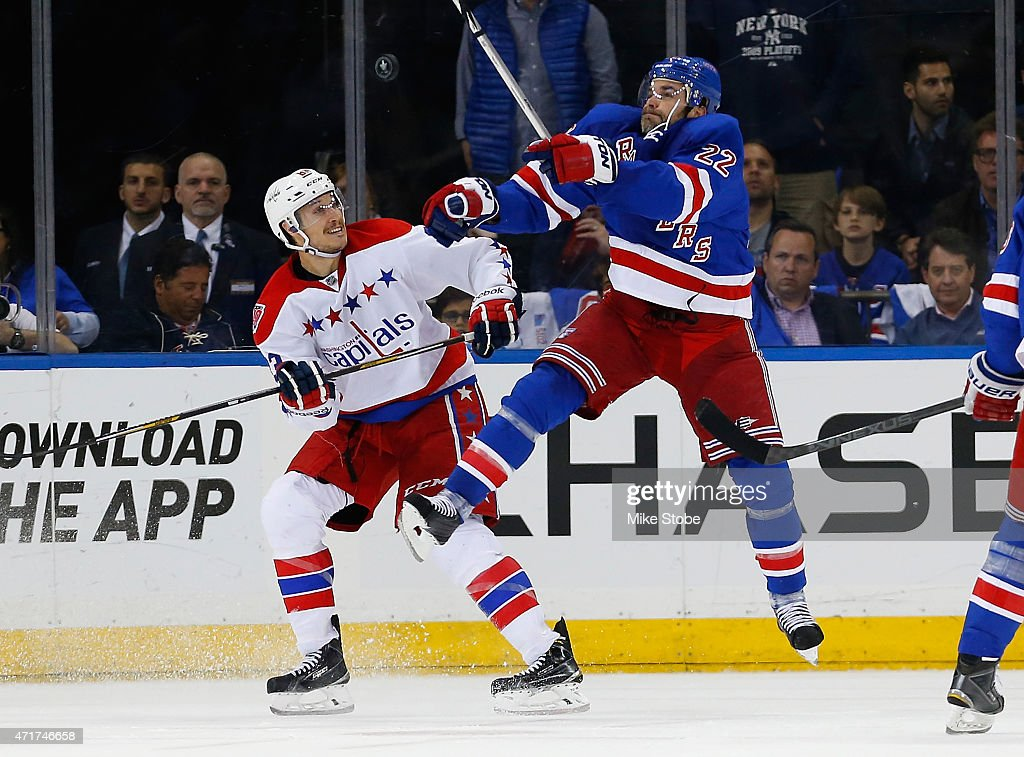 Dan Boyle #22 of the New York Rangers knocks the puck down against the Washington Capitals in Game One of the Eastern Conference Semifinals during the 2015 NHL Stanley Cup Playoffs at Madison Square Garden on April 30, 2015 in New York City.